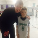 Austin posing with me his coach at an Upward game.