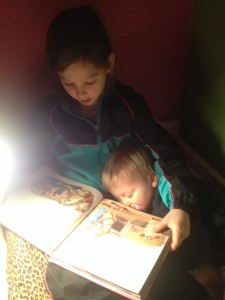 Brooke Reading to Caleb one day before nap.  He was tired!!