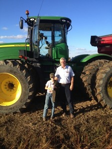 Dad with my son Austin working on the farm.