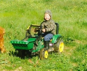 Caleb on his tractor.